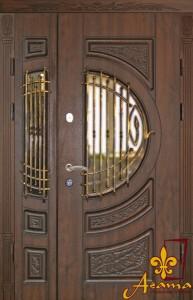 Металеві двері з ковкою